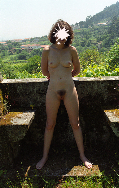 A bitch with a hairy pussy naked outdoor